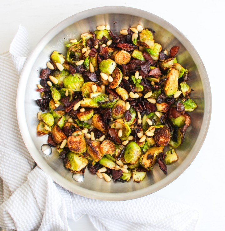 Brussels Sprouts with Balsamic Bacon and Pine Nuts in a stainless steel skillet