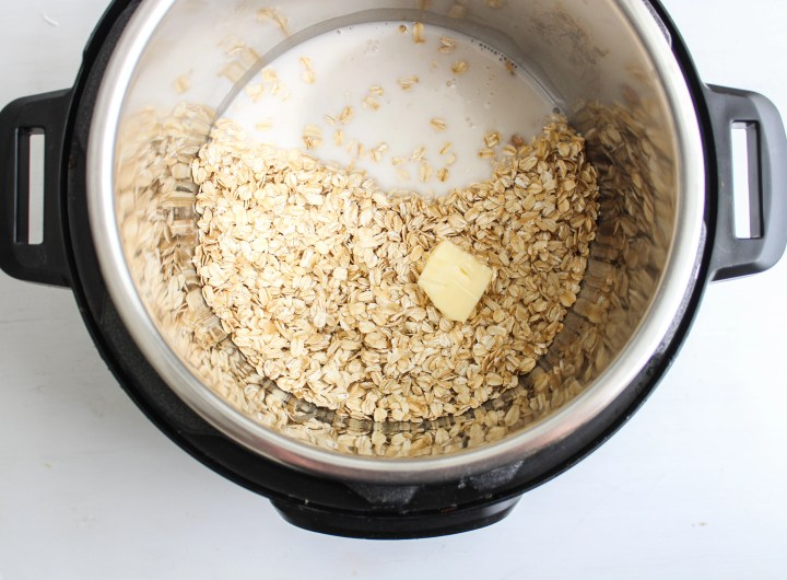 Instant pot filled with oats, almond milk and butter