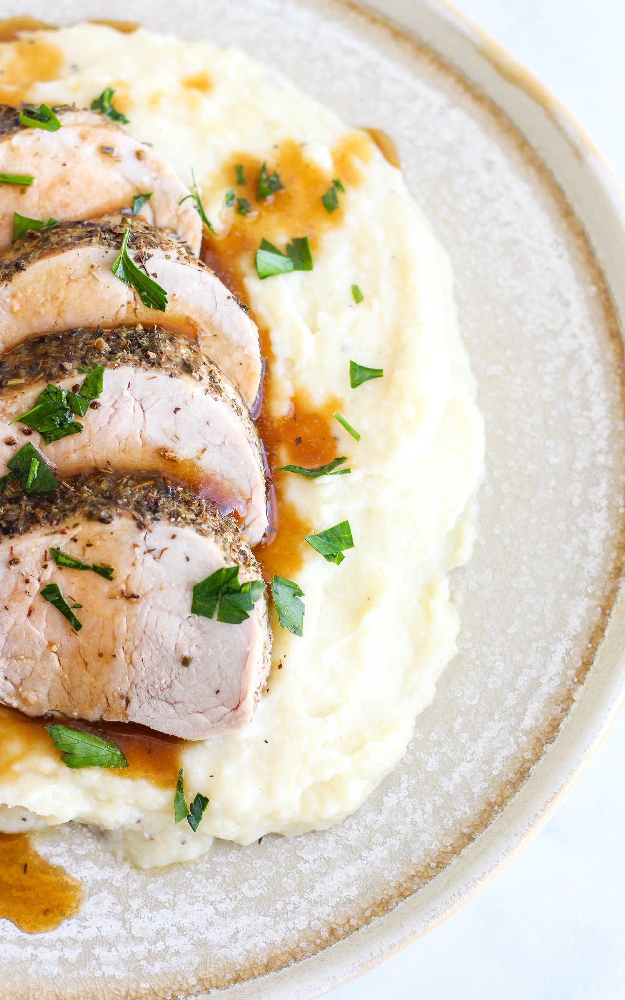 Parsnip puree topped with sliced pork tenderloin and pan sauce