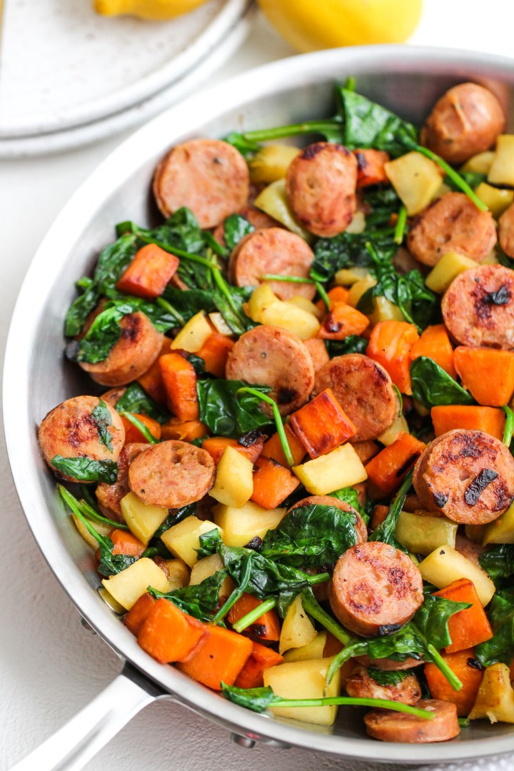 sweet potato and apple sausage breakfast in a stainless steel skillet