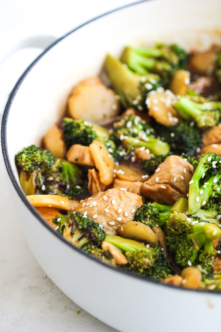 chicken, broccoli and water chestnuts in a large skillet with stir-fry sauce topped with sesame seeds
