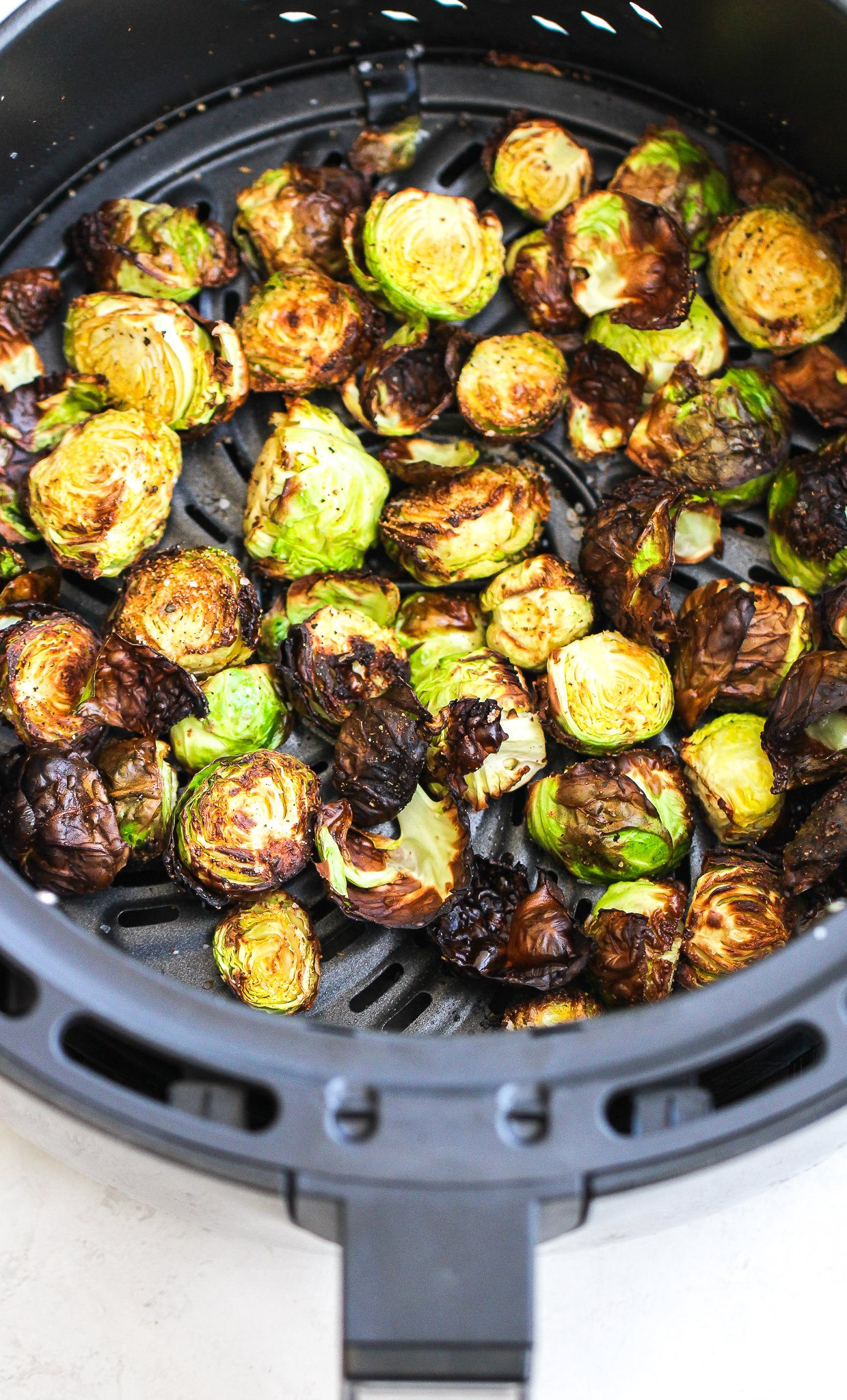 crispy brussels sprouts in the air fryer container