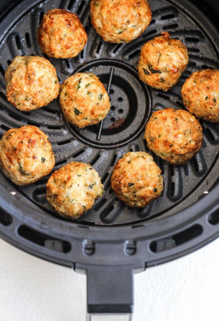 chicken parmesan meatballs in an air fryer basket