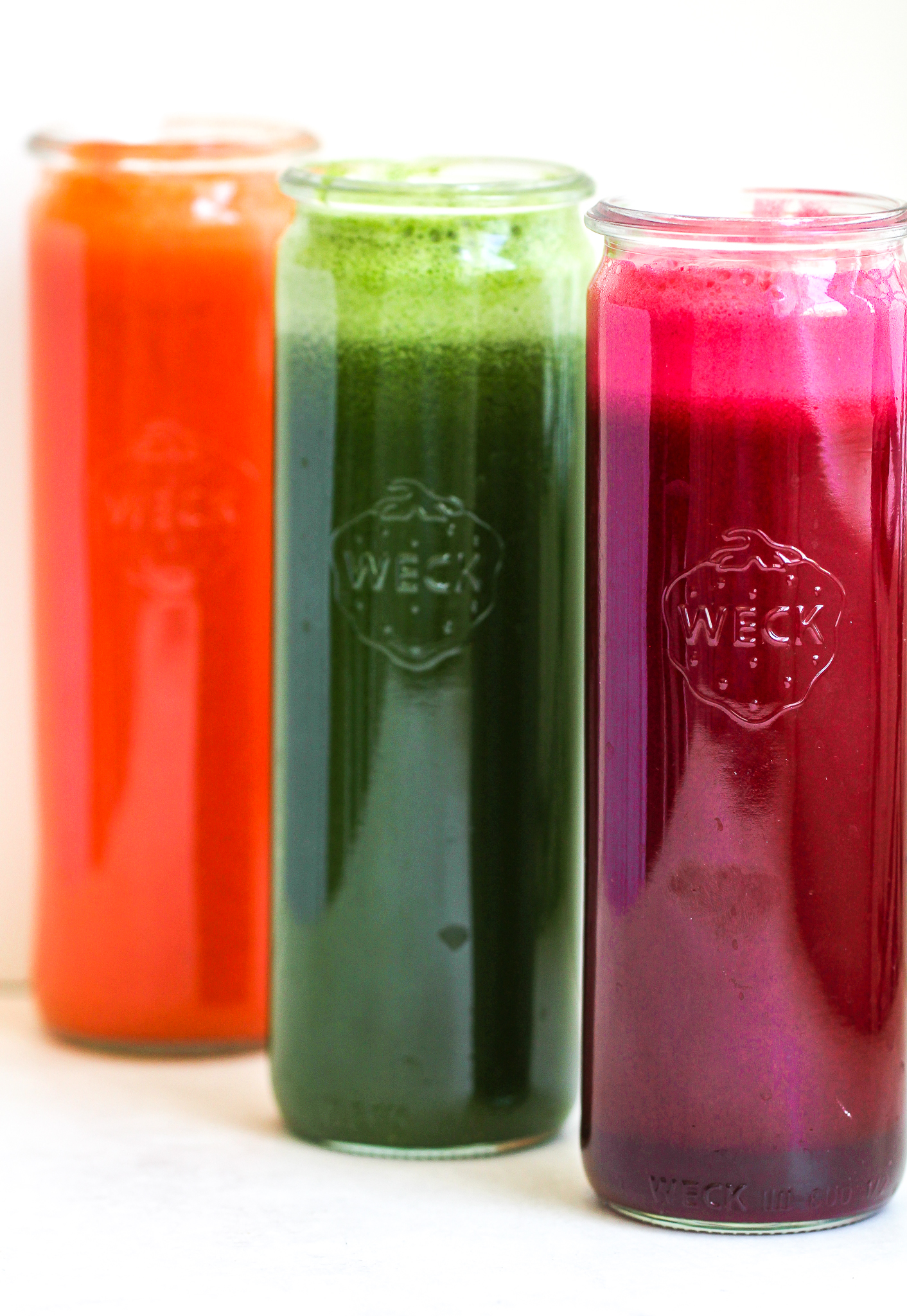 tall glass juice jars filled with 3 immune boosting juices