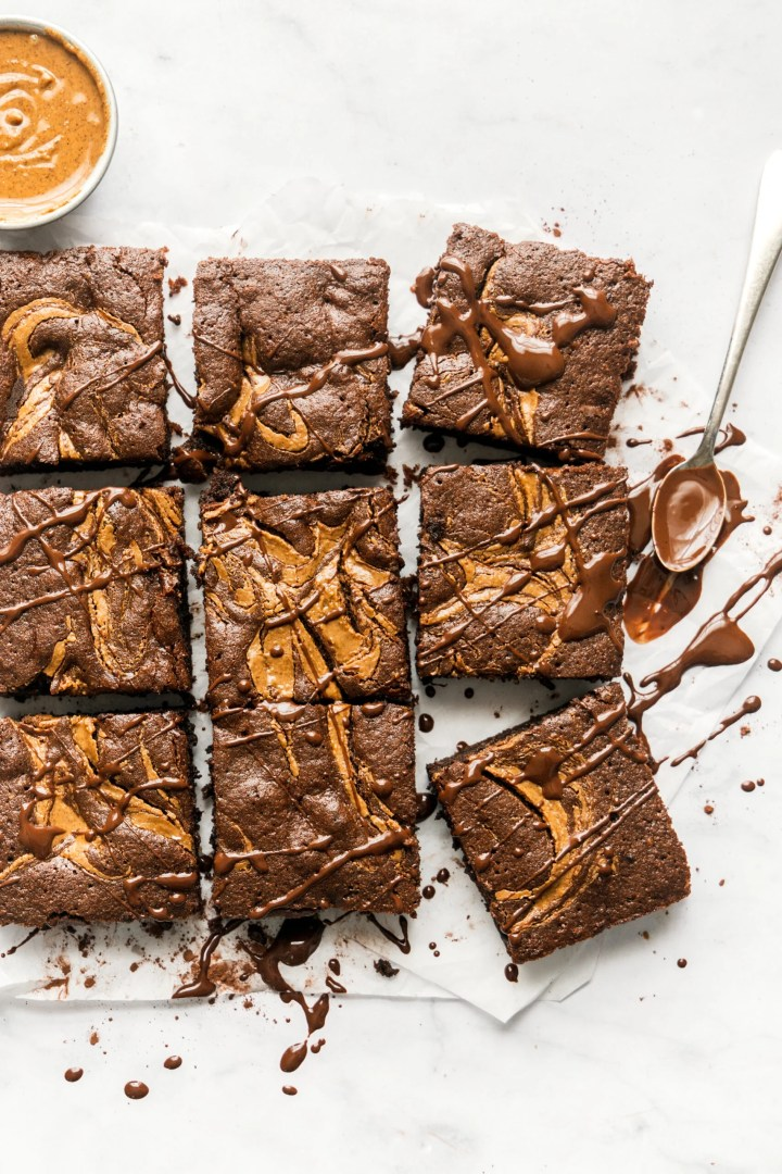 chocolate almond butter brownies cut into squares and drizzled with melted chocolate