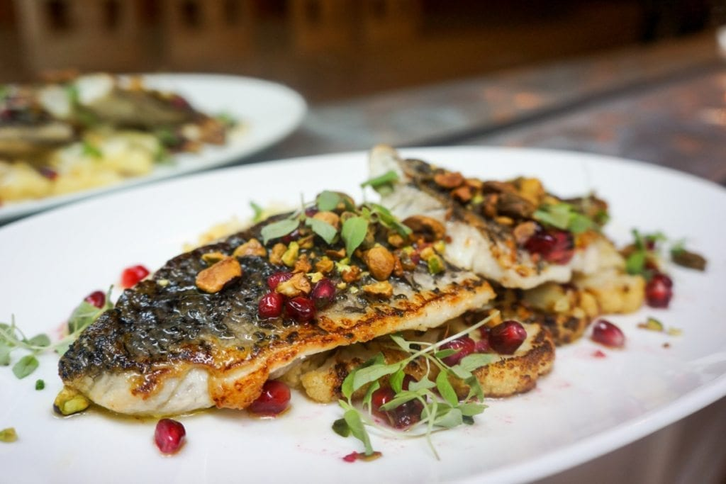 Plancha Grilled Barramundi with Charred Cauliflower and Pomegranate
