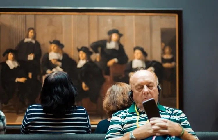 Tourist with audio guide at Rijksmuseum
