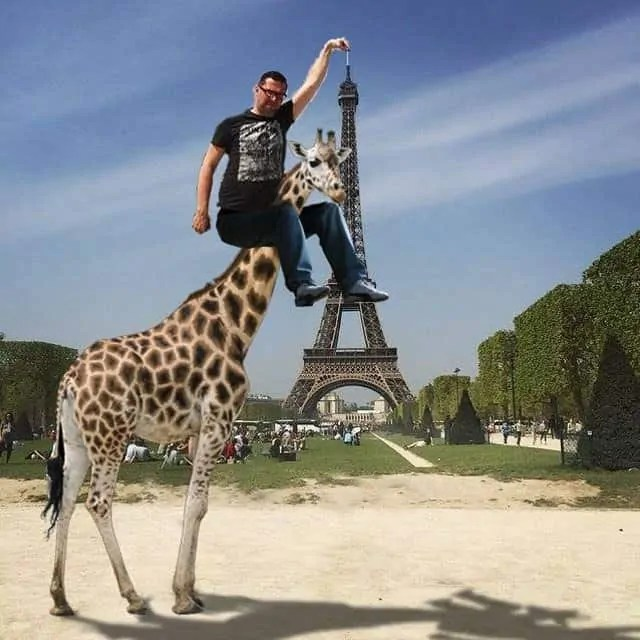 Eiffel Tower finger guy takes the help of a Giraffe