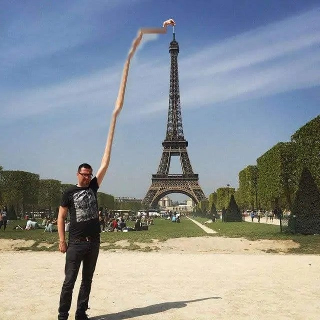 Sid Frisjes stretches himself to become the Eiffel Tower finger guy