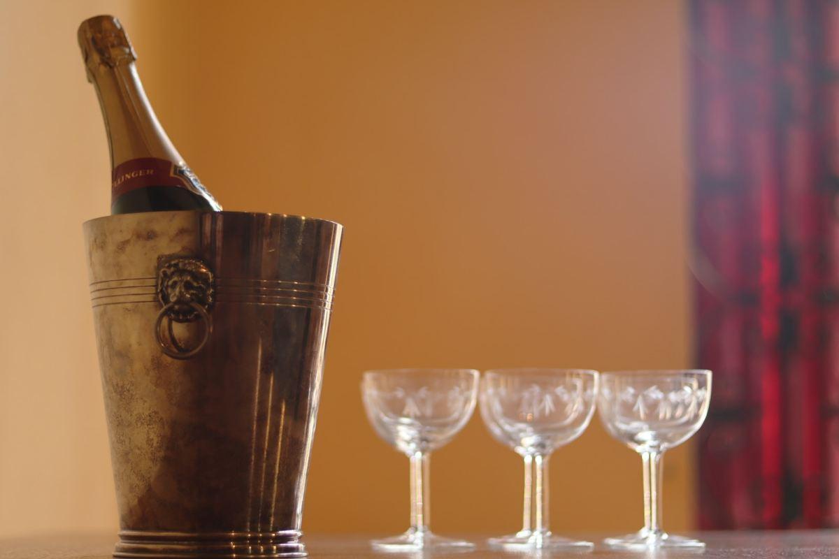 bucket beside three wine glasses