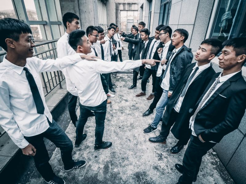 group of man gathering inside room