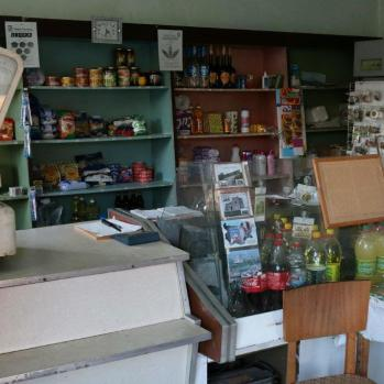 The local shop, which doubles as cafe and bar, selling basic foodstuffs, household goods, vodka and an impressive array of fridge magnets.