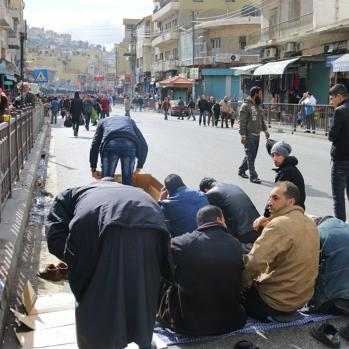 Streets soon packed with men praying - though not always in the same direction, curiously.