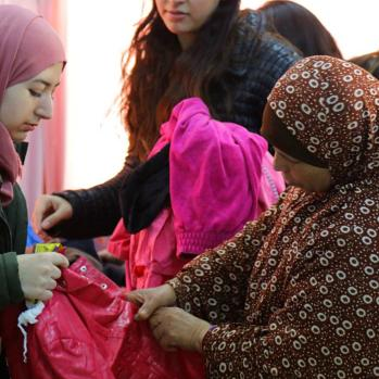 The residents are grateful for the clothes, but it's far from enough. They need self-empowerment. Yet a recent law was a backwards step, requiring all Gaza residents to have work permits and sponsors before they can get a job.