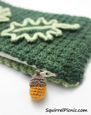 Crochet a tiny acorn as a zipper pull for your clutch.