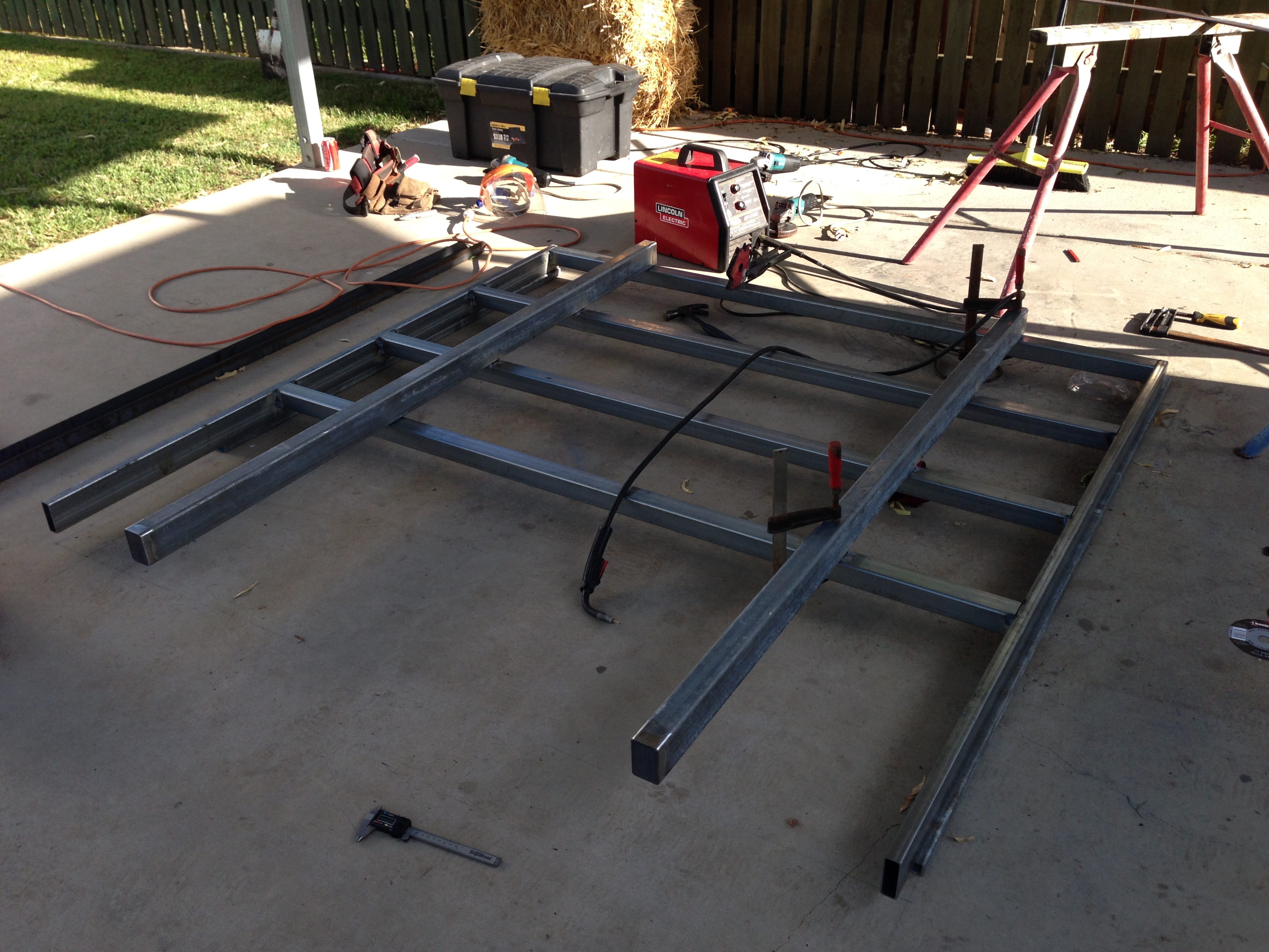 Welding main chassis rails on