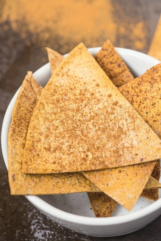 Healthy and Easy Baked Cinnamon Pita Chips which are sweet, salty, crunchy ,crispy and LOADED with flavor without the fat and NO sugar- It's protein packed too! {gluten free, vegan, sugar free recipe