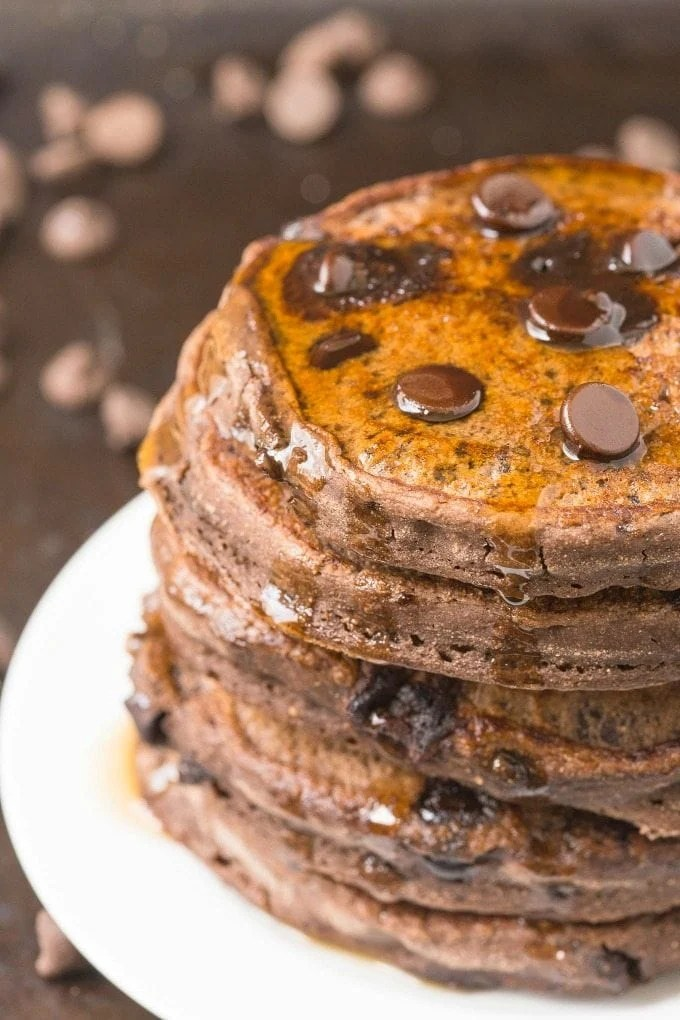 Healthy Thick and Fluffy Low Carb DOUBLE chocolate Pancakes which are SO easy, delicious and low in calories, but you wouldn't be able to tell- The BEST chocolate low carb pancakes out there! {vegan, gluten free, paleo recipe}- thebigmansworld.com