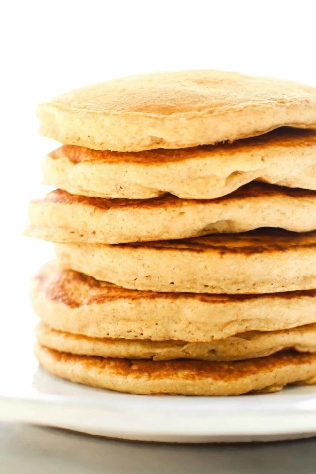 Vegan gluten free banana oatmeal pancakes that are thick, fluffy and flourless.