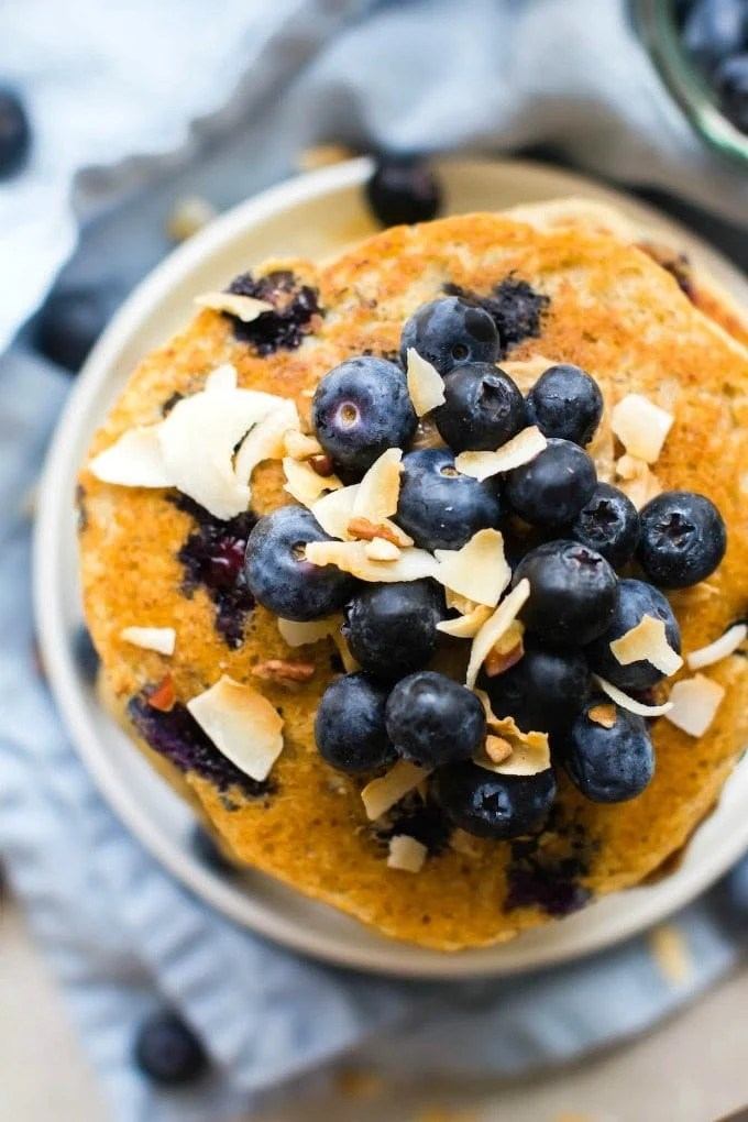 Thick + Fluffy Flourless Blueberry Smoothie Pancakes (V, GF, DF)- Egg-free and healthy blender pancakes made in minutes- Protein-packed, low carb, low calorie and sugar free! {vegan, gluten free, egg-free recipe}- thebigmansworld.com
