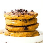 Fluffy Low Carb Keto Chocolate Chip Pancakes topped with chocolate chips