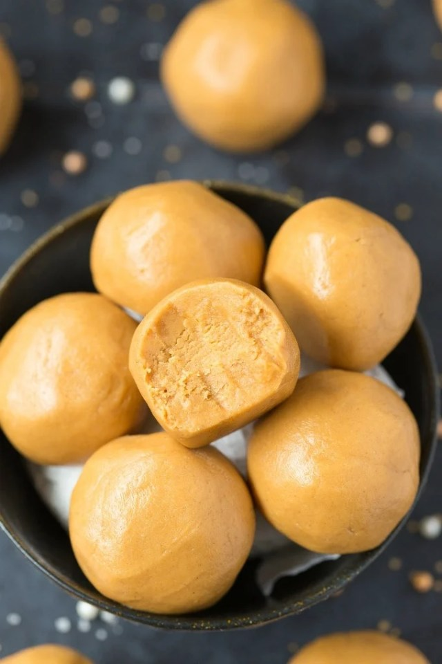 3-Ingredient No Bake Keto Peanut Butter Balls (Paleo, Vegan, Low Carb)- Easy chewy, fudgy no bake peanut butter protein balls recipe ready in 5 minutes and needing 3 ingredients! A quick and easy snack! #peanutbutter #proteinballs #energyballs #ketorecipe | Recipe on thebigmansworld.com