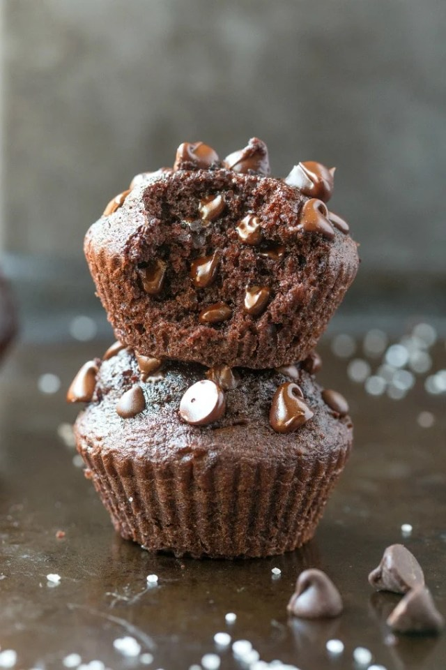 Easy Flourless Gluten Free Vegan Blender Chocolate Muffins stacked on top of one another with the top one cut in half.