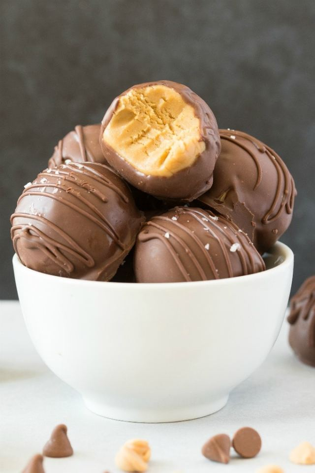 Keto Peanut Butter Truffles covered in chocolate and filled in a white bowl.