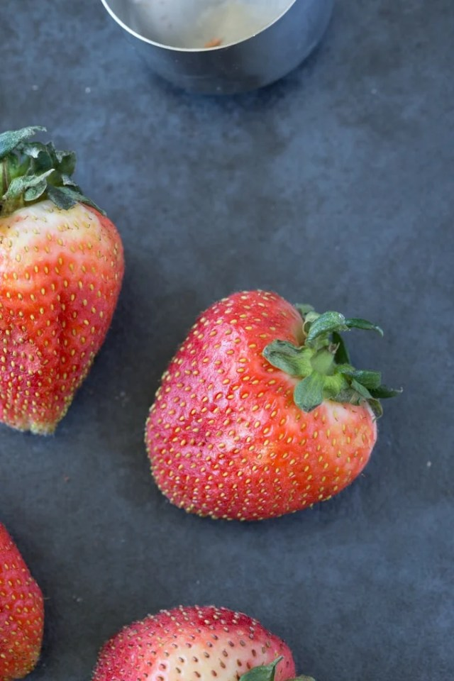 Fresh strawberries to be used in a healthy cheesecake strawberry oatmeal