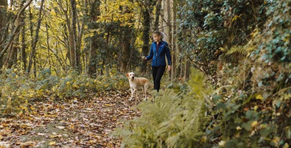 Ruth running with her dog in the woods