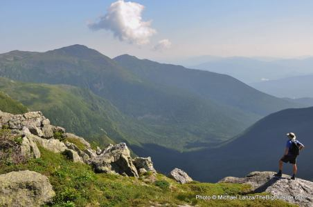A hiker overlooking New Hampshire's northern Presidential Range.