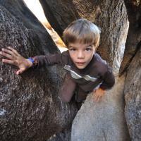 Nate scrambling in Ryan Campground.