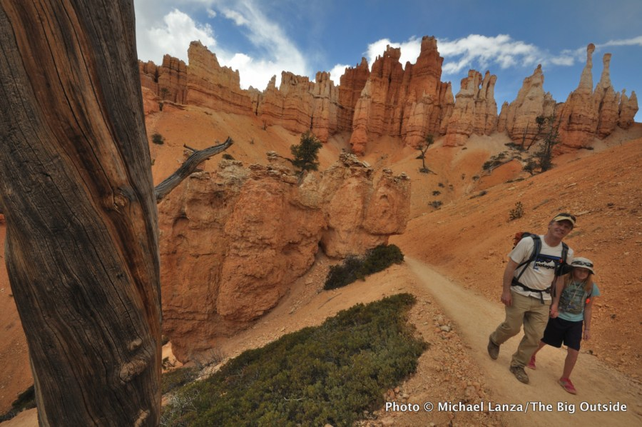 A father and young daughter hiking the Navajo Loop/Queens Garden loop, Bryce Canyon National Park.