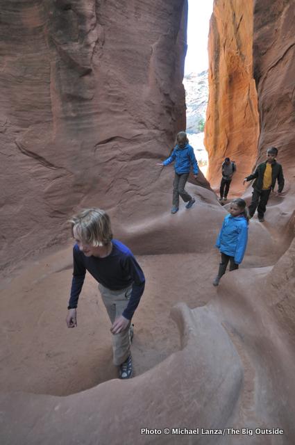 Young kids hiking through Peek-a-Boo Gulch.