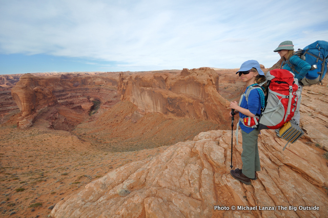 Backpackers above Crack-in-the-Wall on the hike into Utah's Coyote Gulch.