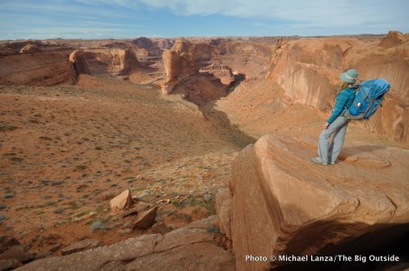 A backpacker above Crack-in-the-Wall, Coyote Gulch, Grand Staircase-Escalante National Monument, Utah.
