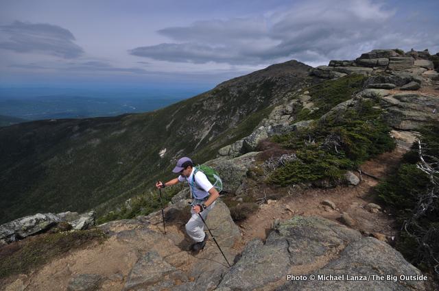 A hiker on Franconia Ridge, White Mountains.