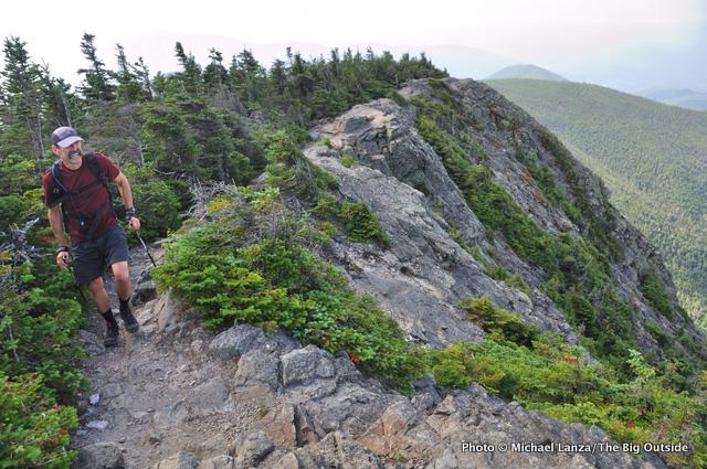 A hiker on Mount Flume, Franconia Ridge, White Mountains.
