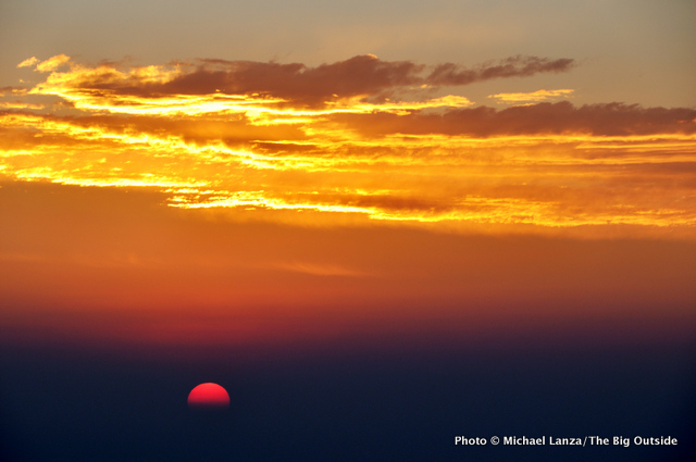 Dawn over wildfire smoke, from the Bears Ears Trail in the Wind River Range.