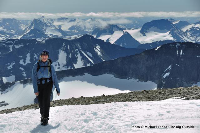A hiker nearing the summit of Galdhøpiggen in Jotunheimen National Park.