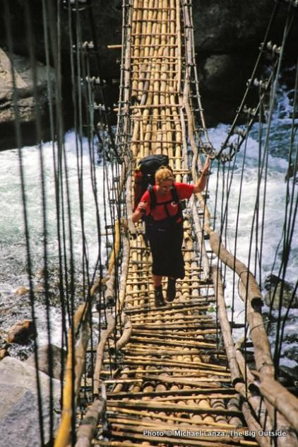 Penny crosses a suspension bridge over the Marsyangdi River.