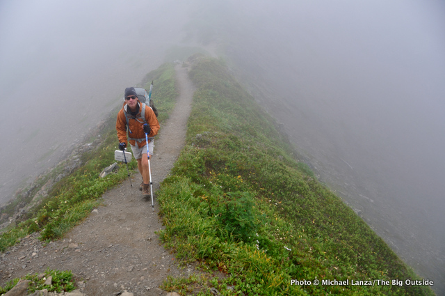 David Ports backpacking through rain and fog in Washington's Olympic Mountains.