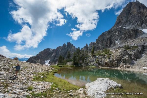 A hiker below Thompson Peak in Idaho's Sawtooth Mountains.