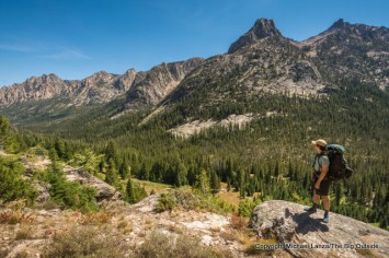 A backpacker above the Redfish Creek Valley, Sawtooth Mountains, Idaho.