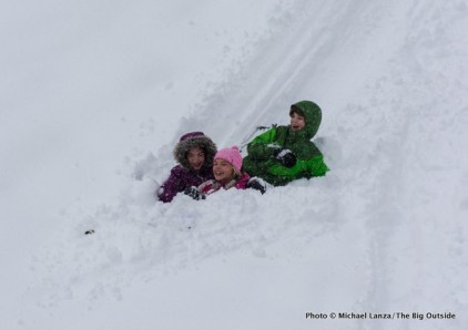 Sledding outside Banner Ridge yurt.