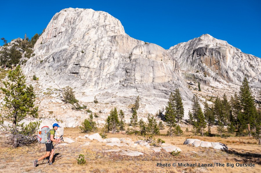 A backpacker hiking through Kerrick Canyon in Yosemite National Park.