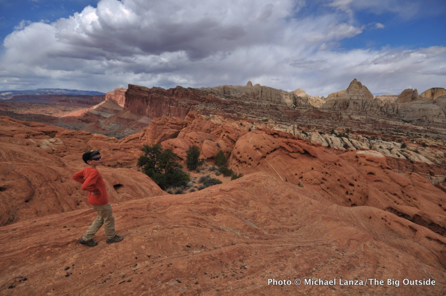 A boy hiking near the Frying Pan Trail in Capitol Reef National Park, Utah.