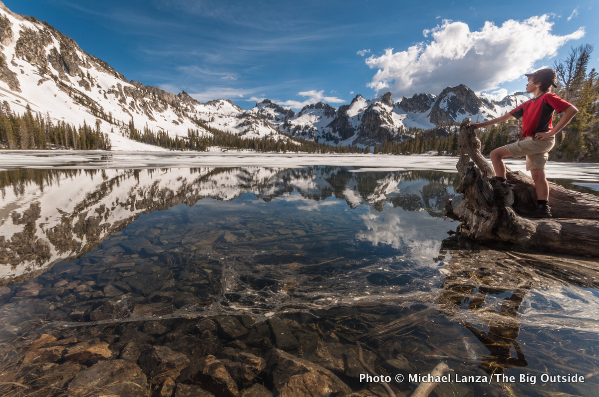 A young teenage boy on a backpacking trip at Alice Lake in Idaho's Sawtooth Mountains.