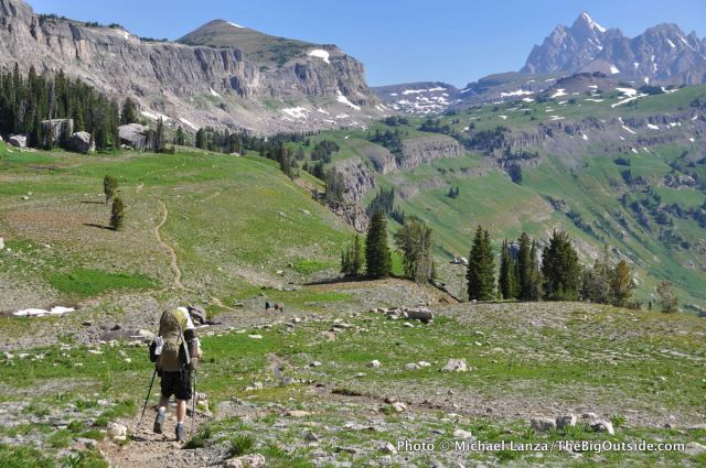 A backpacker on the Teton Crest Trail on Death Canyon Shelf in Grand Teton National Park.
