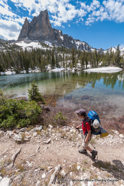 A young boy backpacking below Alice Lake in Idaho's Sawtooth Mountains.